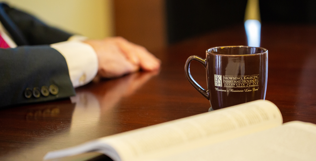 Coffee cup on conference table with open book